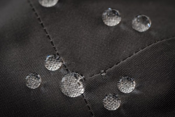 Grey Waterproof Jacket Detail - Close Up with Liquid Droplets